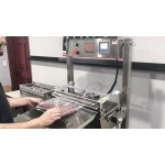 Custom Pak Hi-production vacuum packaging system
